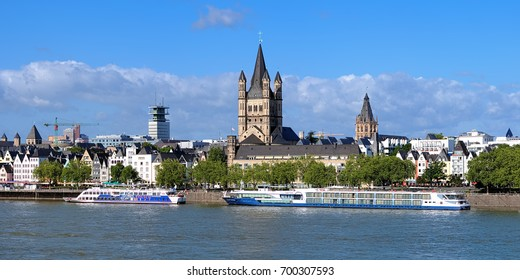 COLOGNE, GERMANY - JUNE 22, 2012: Rhine embankment with cruise ships moored at the berths of KD Company. Koln-Dusseldorfer (KD) is the most famous Rhine cruise operator. It was found in 1853.