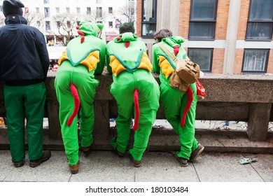 COLOGNE, GERMANY - MARCH 03, 2014: unidentified costumed people along the Rose Monday parade on March 03, 2014 in Cologne. The Rose Monday parade in Cologne is the largest one in Germany.