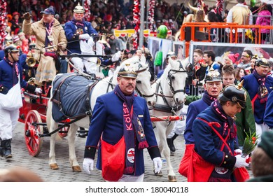 COLOGNE, GERMANY - MARCH 03: unidentified people and the historical fire brigade with a horse carriage at the Rose Monday parade on March 03, 2014 in Cologne. The parade is the largest one in Germany.