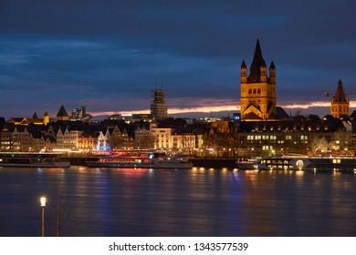Cologne, Germany - March 12, 2019: Cologne Panorama with the Great St. Martin's Church and view of the fish market and the old town of Cologne. Sunset and blue hour.