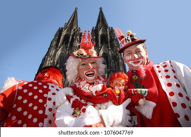 COLOGNE, GERMANY, March 6th 2011: Cologne Carnival Clowns posing in front of Cologne Cathedral on Rose Monday. Costumes are red and white, as these are the colors of Cologne.