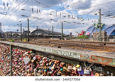 COLOGNE, GERMANY - MAY 12: Bridge full of love locks in Cologne, Germany on May 12, 2019. View to central station.