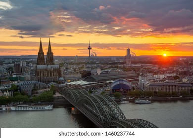 COLOGNE, GERMANY - MAY 12: Cityscape of Cologne, Germany on May 12, 2019 during sunset. View from Triangle tower to the cathedral and Hohenzolern Bridge.
