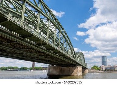 COLOGNE, GERMANY - MAY 12: Hohenzollern bridge in Cologne, Germany on May 12, 2019. View to Triangle tower.