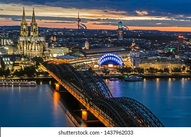 COLOGNE, GERMANY - MAY 12: Night cityscape of Cologne, Germany on May 12, 2019. View from Triangle tower to the cathedral and Hohenzolern Bridge.