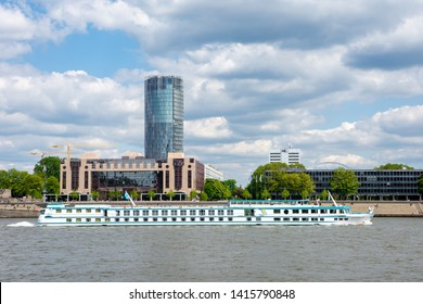 COLOGNE, GERMANY - MAY 12: Passenger ship passing the Triangle Tower in Cologne, Germany on May 12, 2019.