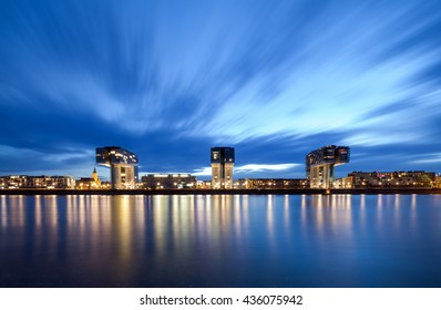 COLOGNE, GERMANY - MAY 28, 2015: Modern Kranhaus or crane house building complex over Rhine river in Cologne at night