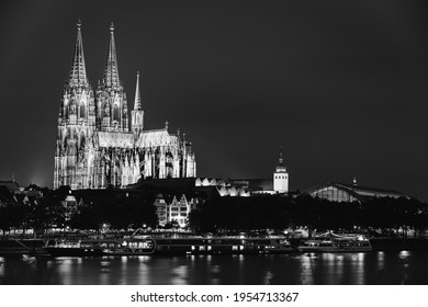 Cologne, Germany. Night View Of Cologne Cathedral. Catholic Gothic Cathedral In Night. UNESCO World Heritage Site. Black And White Colors.