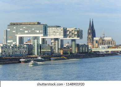 Cologne, Germany: November 18 2017: The Cologne Crane Houses in the Harbour Quarter and the Cologne Cathedral seen from River Rhine.