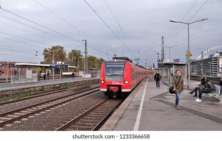 Cologne / Germany - November 2 2018: A modern red DB BR 425 S-Bahn / Regional Express train at the railway station of Cologne / Köln Messe Deutz