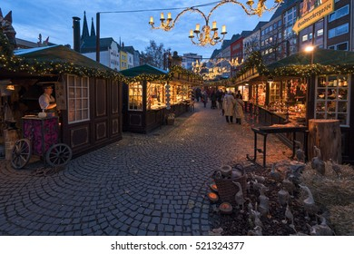 COLOGNE, GERMANY - NOVEMBER 21, 2016: Christmas Market in COLOGNE in Front of the Cologne Cathedral. Craftsmen offer their products. Many tourists visit one of the most popular markets in Germany.