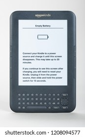 "Cologne, Germany - October 18 2018: Amazon Kindle 3 with error message ""Empty Battery"". This message is persistent, even when the battery is damaged or removed."
