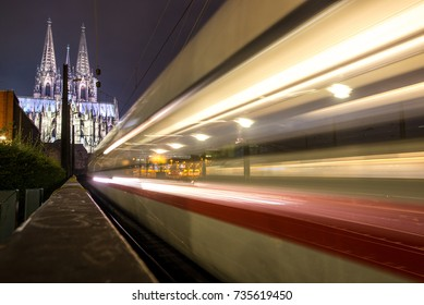 COLOGNE / GERMANY - OCTOBER 2017 30 Second exposure of a Deutsche Bahn Intercity Express Train leaving Cologne Main-station about to cross the river rhine with the Cathedral in the background.