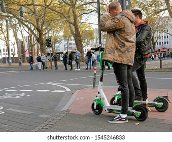 Cologne, Germany - October 27, 2019: E-mobility in Germany: Inhabitants of Cologne trying out electric scooters.
