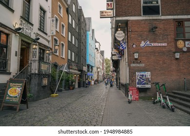 Cologne, Germany - October 4 2019: A cobblestone street in Altstadt Nord District lined with restaurants and pubs
