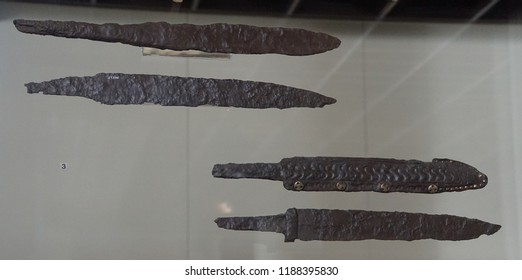 COLOGNE, GERMANY - SEP 15, 2016 - Ancients sword blades and other weapons from an archaeological dig,  Roman - Germanic Museum,  Cologne, Germany