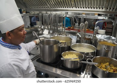 COLOGNE, GERMANY - SEP 15, 2016 - Chef supervises the kitchen of a river cruise ship, Germany