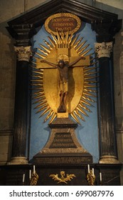 COLOGNE, GERMANY - SEP 15, 2016 - Golden crucifix on  altar  in St Peter's Cathedral,  Cologne, Germany