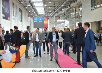 Cologne, Germany - September 16, 2015 - Young business people rushing by on digital marketing exhibition and trade show Dmexco