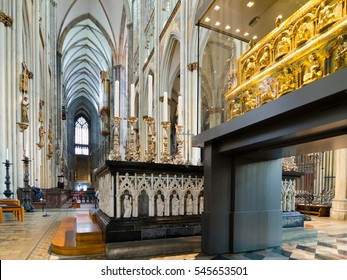 Cologne, Germany - September 17, 2015: Interior of the Cologne Cathedral. Roman Catholic cathedral in gothic style. Nave, ceiling, organ, columns and stained glass. World Heritage Site.
