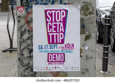 Cologne, Germany - September 18, 2016:TTIP Demonstration. A poster advertising a rally against the American TTIP trade deal is left up on a public street after the demonstration.