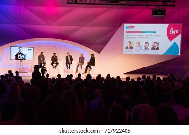 Cologne, Germany - September 19, 2017 - Young business people at digital marketing exhibition and trade show Dmexco in Cologne