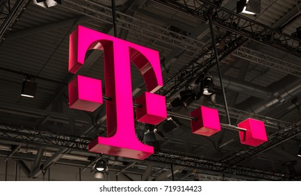 """COLOGNE, GERMANY SEPTEMBER, 2017: Logo of Deutsche Telekom. There are around 750 so called """"T-Punkt"""" shops which sell products and services of Deutsche Telekom."""