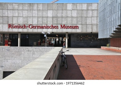 COLOGNE, GERMANY - SEPTEMBER 22, 2020: People walk by Romisch-Germanisches Museum in Cologne city, Germany. Cologne is the 4th most populous city in Germany.