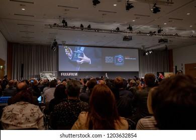 COLOGNE, GERMANY - SEPTEMBER 25, 2018: Fujifilm Holdings Corporation announces 100 Megapixel medium format mirrorless camera at Photokina 2018 event