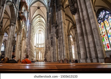 COLOGNE, GERMANY - SEPTEMBER 4, 2018:  Interior view of historic Saint Peters Cathedral Domkirche with people and architecture