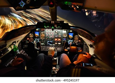 COLOGNE, GERMANY - WINTER 2015 4 seconds exposure of a Learjet 31A Cockpit at night during a 25 degree bank left turn to intercept the ILS (Instrument Landing System).