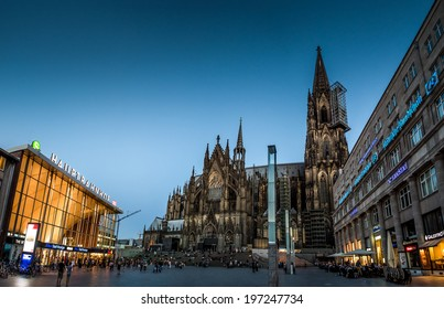 Cologne - June 7th, 2014, people are enjoying the first summer evening on the public platform in front of the famous cathedral, with the main train station to the left.