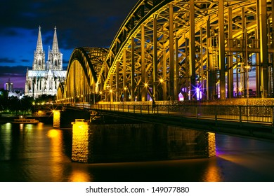 A Cologne night scape with the Hohenzollernbr�¼cke in the foreground.