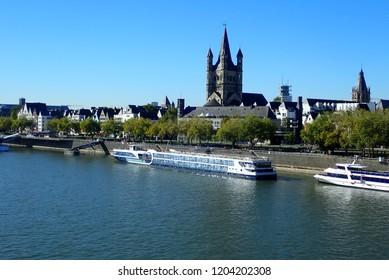 Köln (Cologne), Nordrhein-Westfalen/Deutschland - 09-27-2018: The Skyline of Cologne (Köln) as seen from the Hohenzollernbrücke. It's a train and pedestrian bridge over the river Rhein.