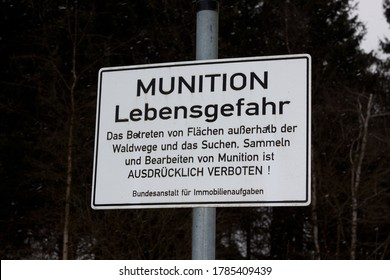 Cologne, NRW, Germany - 06.09.2013 : Warning sign for world war 2 duds in a forest area.