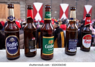 Cologne, NRW/Germany February 12 2018: Various empty beer bottles of different brands of local beer during the traditional carnival parades in Cologne.