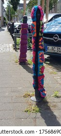 Cologne, NRW/Germany - Mai 24, 2020, Colorful knitted wool covering car posts