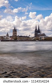 Cologne Panorama, daytime with cloudy sky on the Rhine, in the background the Cologne Cathedral and the Great St. Martin's Church.