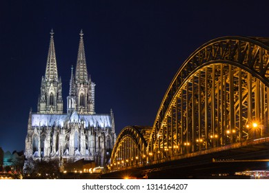 Cologne skyline with Cologne Cathedral and Hohenzollern bridge at night, long exposure shot