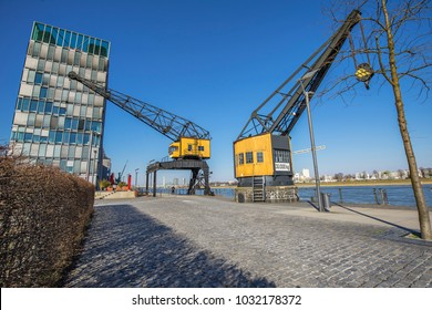Cologne - View to former Harbour Cranes at River Rhine Waterside, North Rhine Westphalia, Germany, Cologne, 23.02.2018