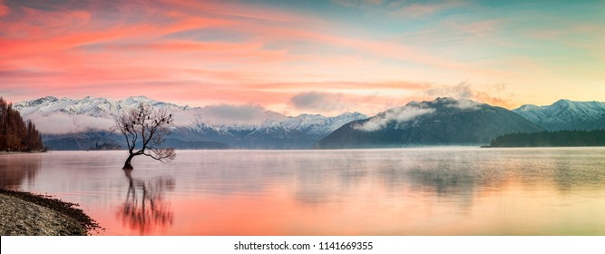A cololourful sunrise on a frosty winter morning at Lake Wanaka, in the South Island of New Zealand.
