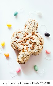Colomba pasquale , dove, with multi colored eggs and on a white background, top view, natural window light.
