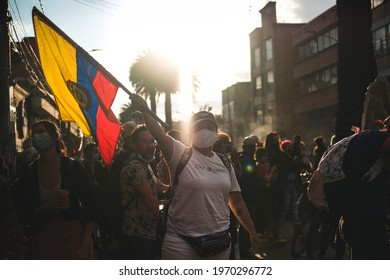 BOGOTÁ, COLOMBIA - 7 MAY, 2021: A woman holding the colombian flag in an artistic protest in the framework of the national strike against Ivan Duque government