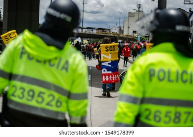 BOGOTÁ, COLOMBIA - APRIL 25, 2019: Riot Police squad appears behind protesters from Universidad Nacional during the march Ph: Sebastián Barros.