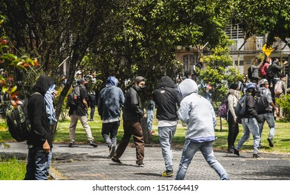 BOGOTÁ, COLOMBIA - AUGUST 15, 2018: Students of Universidad Nacional de Colombia, riot against police brutality inside university grounds, as police is trying to get in.