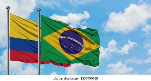 Colombia and Brazil flag waving in the wind against white cloudy blue sky together. Diplomacy concept, international relations.