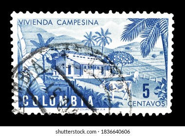 COLOMBIA - CIRCA 1950 : Cancelled postage stamp printed by Colombia, that shows Colombian farm, circa 1950.