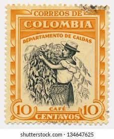 COLOMBIA - CIRCA 1956: A stamp printed in Colombia, shows Coffee picker, Caldas, circa 1956