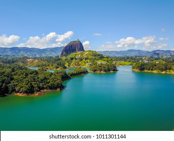 Colombia Medellin district Guatape aerial landscape view with drone of Penol lake and the famous homonym big rock in a sunny day with blue sky a very popular tourist destination.
