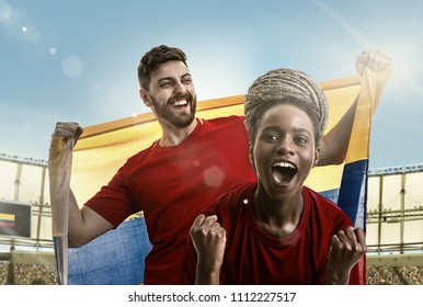 Colombian couple athlete / fan celebrating in the stadium